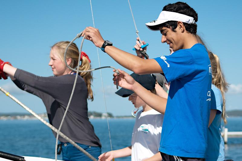 Children preparing racing dinghies at championships. April 18, 2013: Editorial