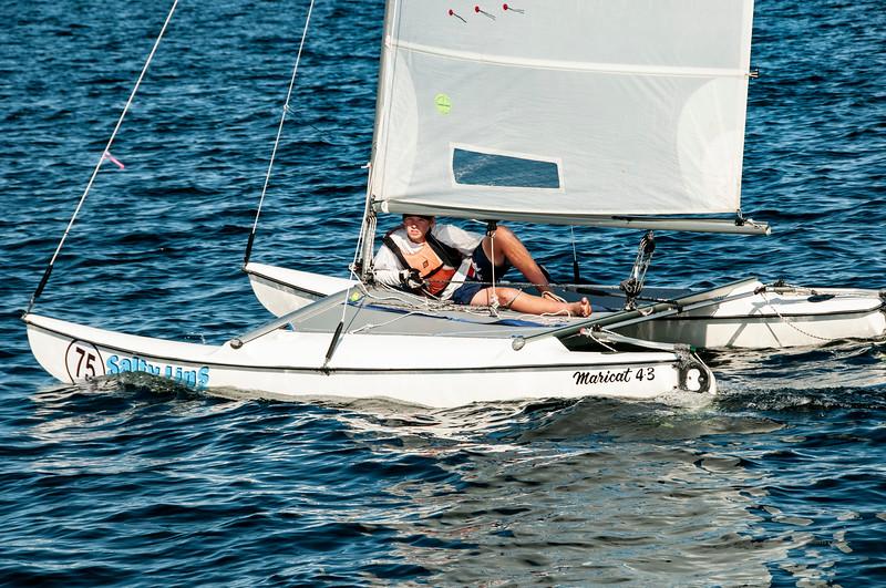 Children sailing racing dinghies at championships. April 18, 2