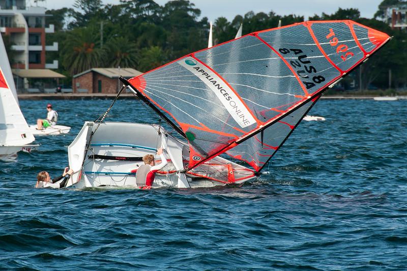 Capsized sailing racing dinghy. April 16, 2013: Editorial