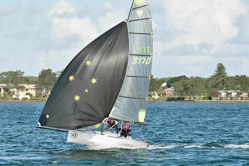 Children sailing racing dinghies at championships. April 17, 2