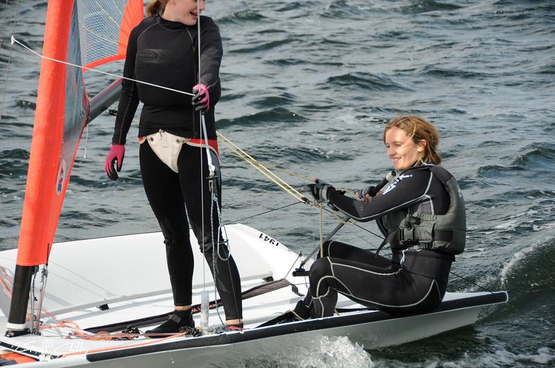 Children close up sailing racing dinghies. April 16, 2013: Editorial