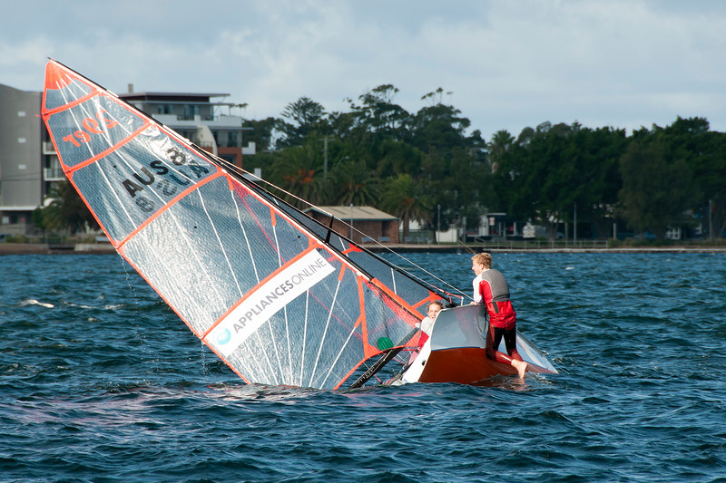 Children in overturned sailing racing dingy. April 16, 2013: E