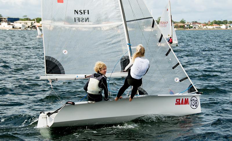 Children sailing racing dinghies. April 16, 2013: Editorial