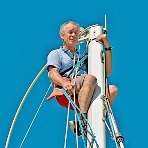 Man Climbing a Yacht Mast.