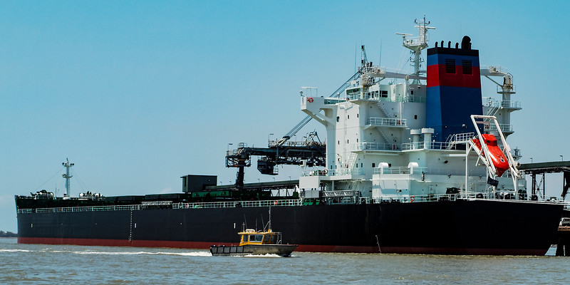 A 229 meter Bulk Carrier Ship loading at a Gladstone Harbour terminal. Queensland, Australia