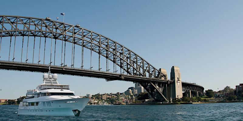 Super luxury 45mtr motor yacht passing under Sydney Harbour Bridge, Sydney Harbour, Australia.
