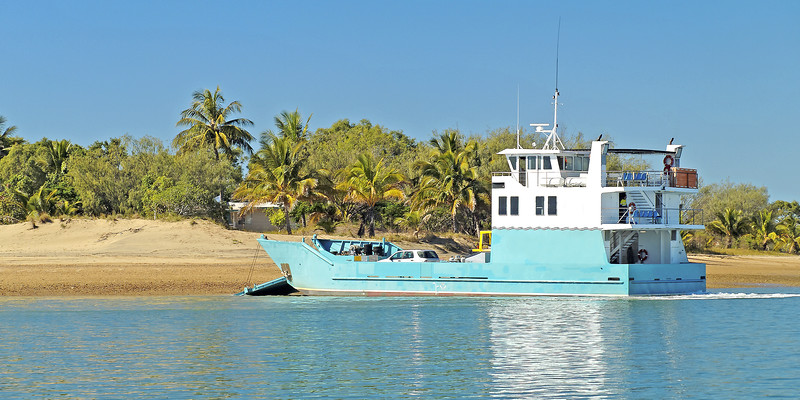 Transporter Ferry delivering goods to a tropical island.