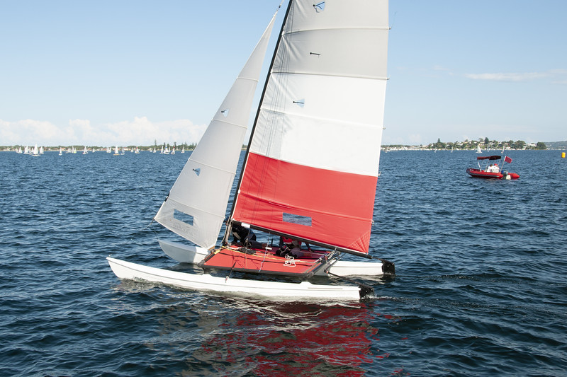 Children Sailing a catamaran sailboat at speed with one hull air