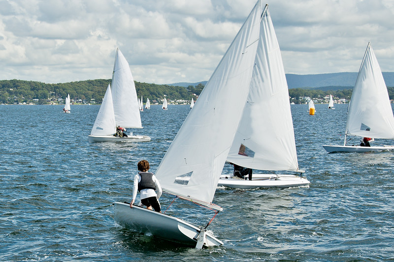 Child sailor on watch in close school children sailboat racing o