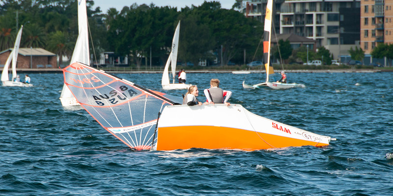 Capsized competitors sailing racing dinghies. April 16, 2013: Editorial