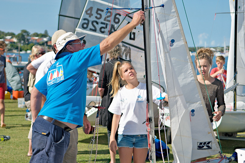 Children preparing racing dinghies at championships. April 18,