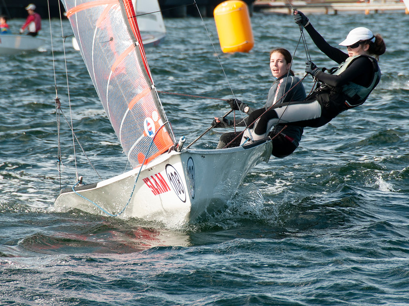 Two girls sailing racing dinghies. April 16, 2013: Editorial
