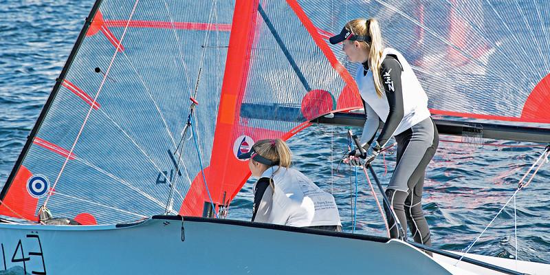 Children sailing dinghies.