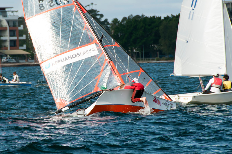 Children sailing racing dingy capsize. April 16, 2013: Editorial