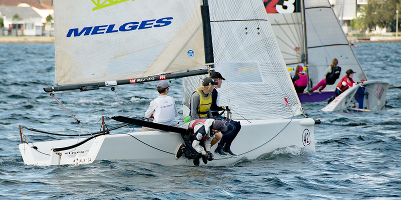 Children sailing racing dinghies. April 16, 2013: Editorial