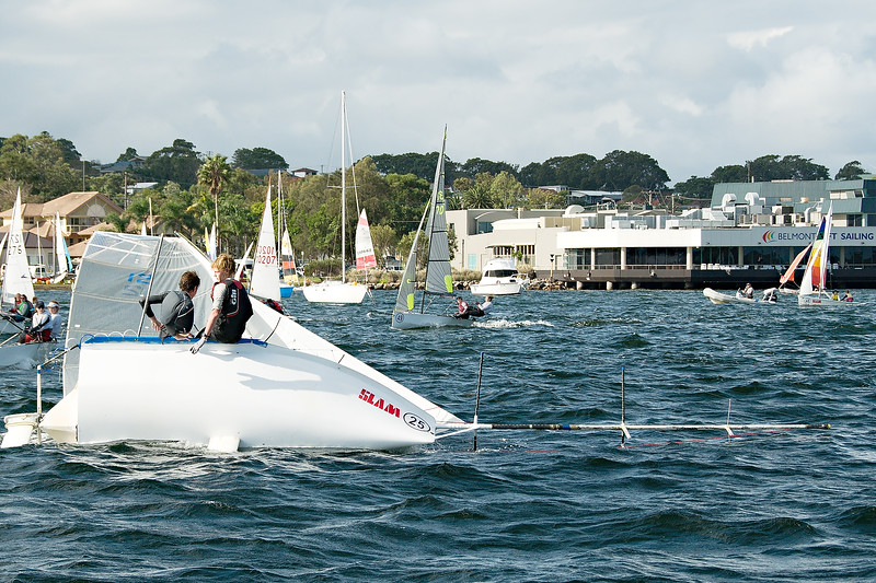 Kids in an overturned sailing racing dinghy. April 16, 2013: Edi