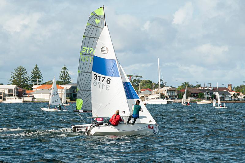 Kids sailing racing dinghy. April 16, 2013: Editorial