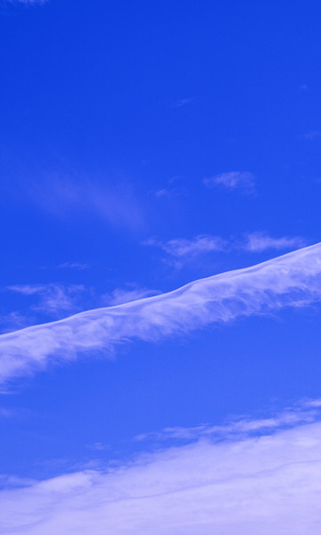 Magnificent white Contrail Cirrus cloud in blue sky. Australia.