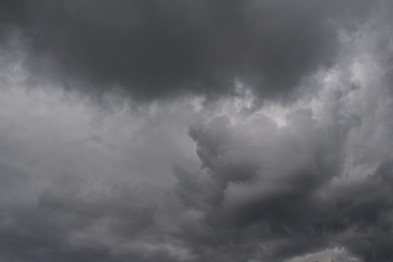 Grey stormy cumulonimbus cloud closeup. Australia. Atmospheric sky art image.