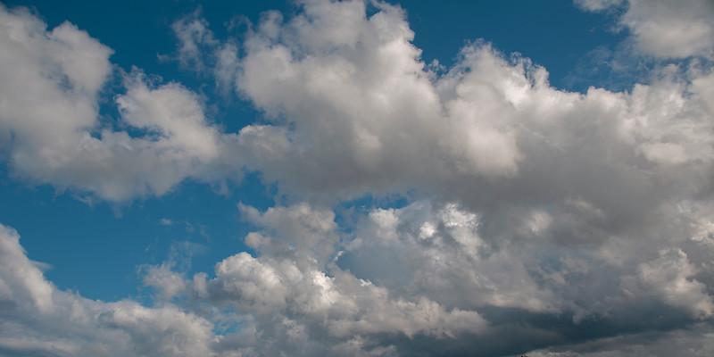 A heavy weather meteorological sky cloudscape scene, with white Cumulus cloud in blue sky. Australia.