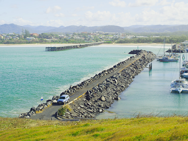 Coffs Harbour Marina rock breakwall and ocean timber jetty.