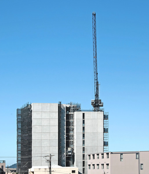 Building series. Vertically extended industrial crane on the new Multistory Unit building under construction at 277 Mann St. Gosford. March 18, 2020.