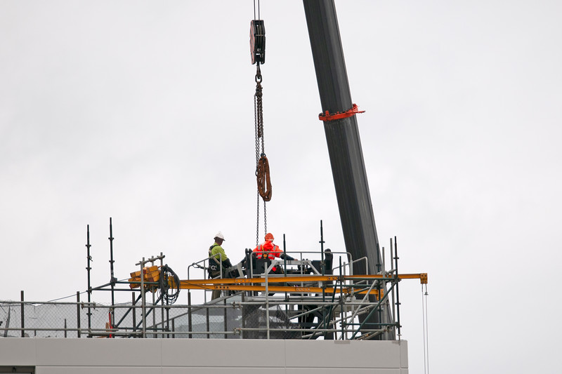 Building series. Workers removing the Construction Crane on the new Multistory Unit building under construction at 277 Mann St. Gosford. May 23, 2020.