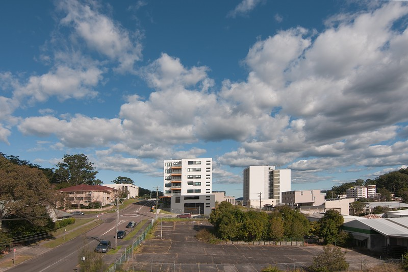 Gosford City Landscape with  recently completed home units at Mann St. and white  Cumulonimbus cloud in blue sky. Australia. June 22, 2020.