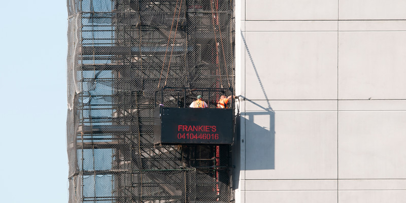 Working from a Man Cage on the new Multistory Unit building under construction at 277 Mann St. Gosford. February 25, 2020.