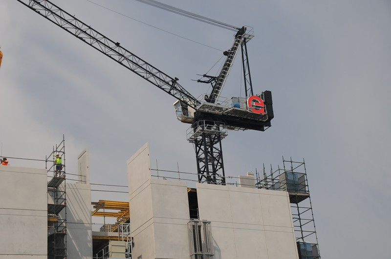 Working Construction Crane on Multistory Units.  November 2, 2019. Part of a series.