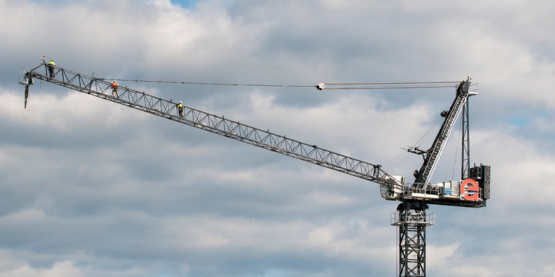Riggers assembling a Construction Crane on Multistory Units.  May 11, 2019. Part of a series.