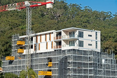 Gosford, NSW, Australia - July 15, 2021: Safety netting and scaffolding now removed on the now completed top floors of new social housing.