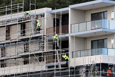 July 15, 2021. Workers disassembling scaffolding on now completed top floors of home unit block at 56-58 Beane St.