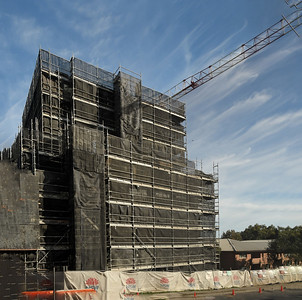Gosford, NSW, Australia - May 2, 2021: Top floor construction activity on New Social Housing construction. Part of a Series