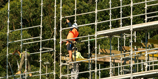 Installing scaffolding and flooring concrete formwork. Construction progress on new building site at 56-58 Beane St. Gosford, Australia. April 19, 2021.Part of a series.