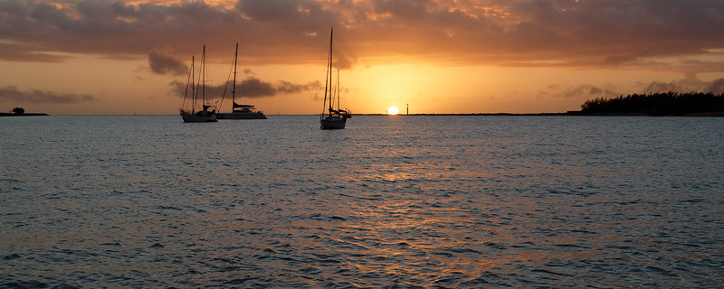 Orange Coloured Sunrise Seascape with yachts at anchor. Australia