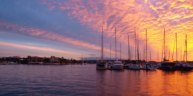 Vibrant orange tropical Marina Sunset Seascape.