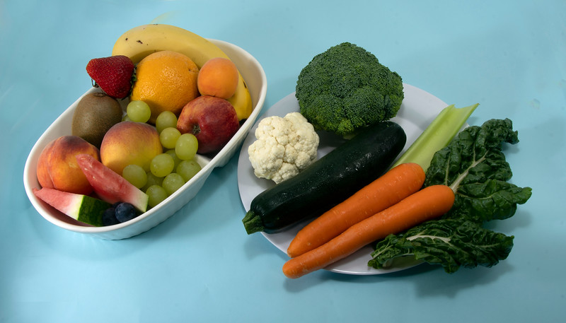 Fruit and Vegetables isolated on blue.