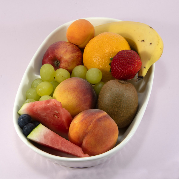 Colourful fresh Fruit isolated on pale pink.
