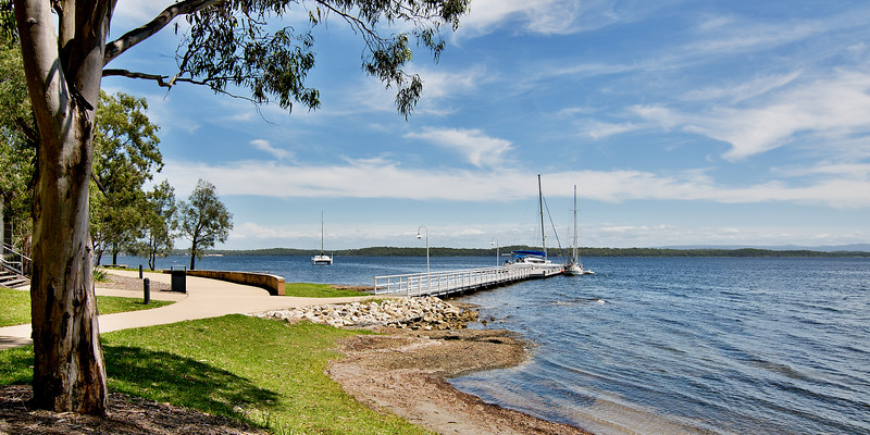 Waterfront maritime parkland marina/dock with boats.