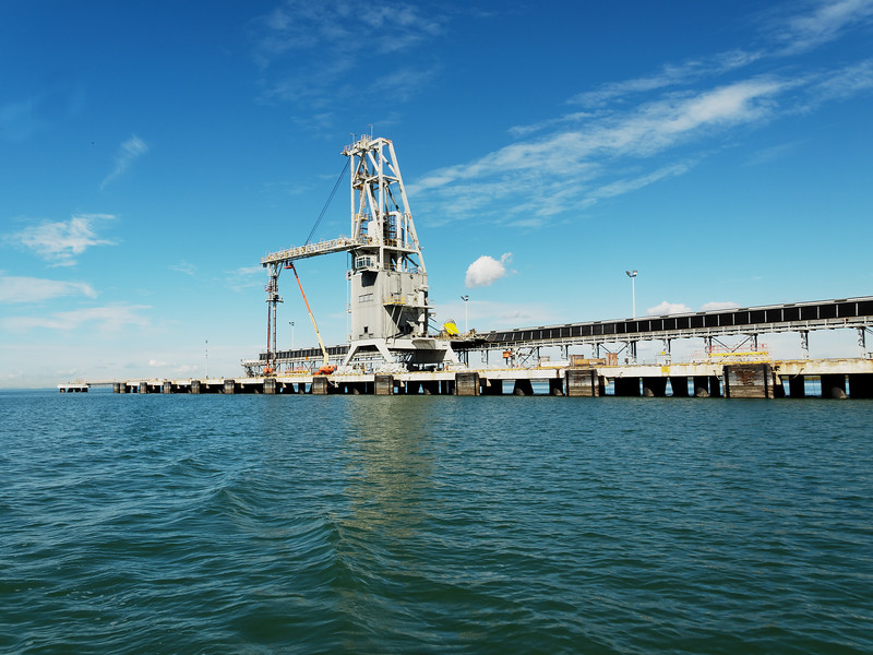 Export coal shipping terminal with loading gantry crane in Port Gladstone.