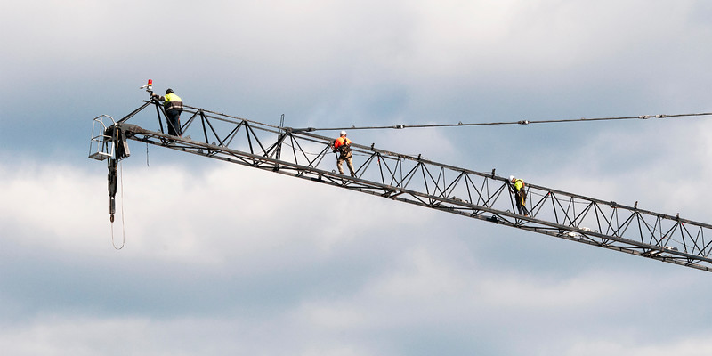 Assembling a Working Construction Crane on Multistory Units.  May 11, 2019. Part of a series.
