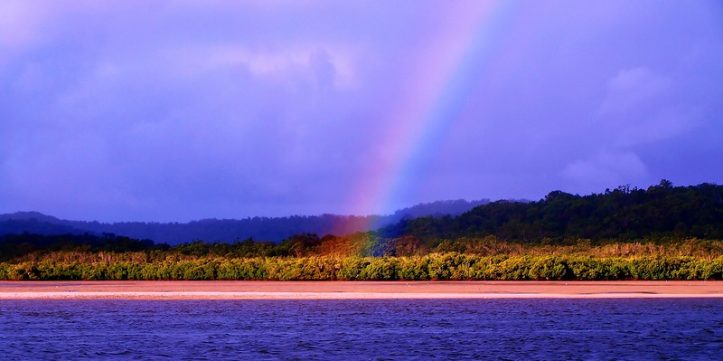Translucent vibrant Rainbow near water.