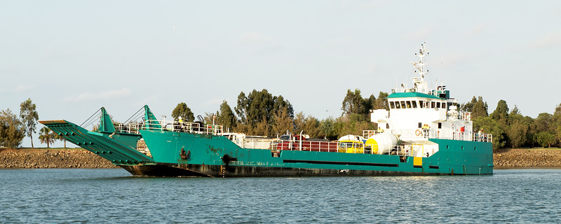 Commercial Water Craft Transporter Ferry delivering vehicles and goods goods to a tropical marina complex Gladstone