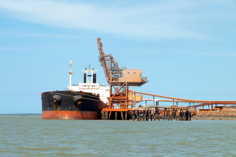 A 254 meter Ore Carrier Ship unloading Bauxite at Gladstone Harbour, Queensland, Australia.