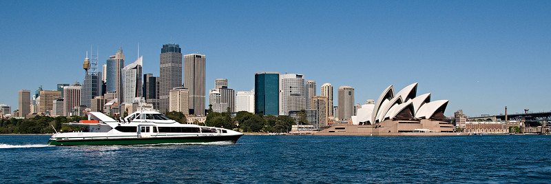 Sydney Opera House and the CBD skyline with a fast Rivercat Ferry in the forground.