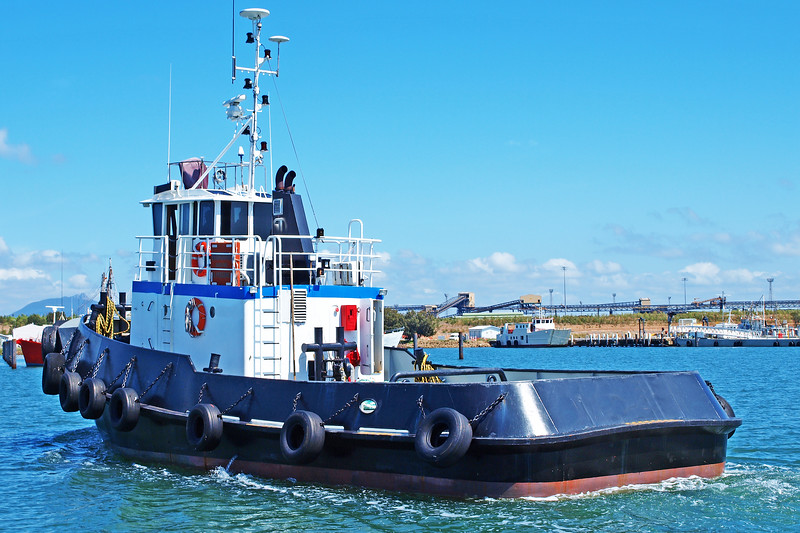 An 18 meter Commercial Tug Boat under way in Gladstone Marina Harbour. Queensland, Australia.