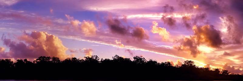 Golden colored tropical sunset cloudscape.