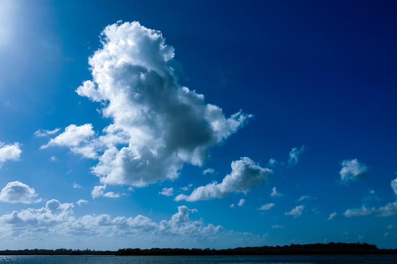 Bright white Cumulonimbus cloud in blue sky. Australia.