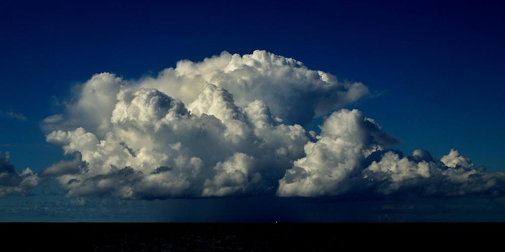 White billowing cumulus storm cloud photo.